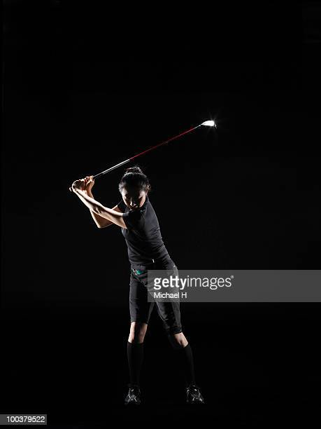 Lady golfer who swings driver