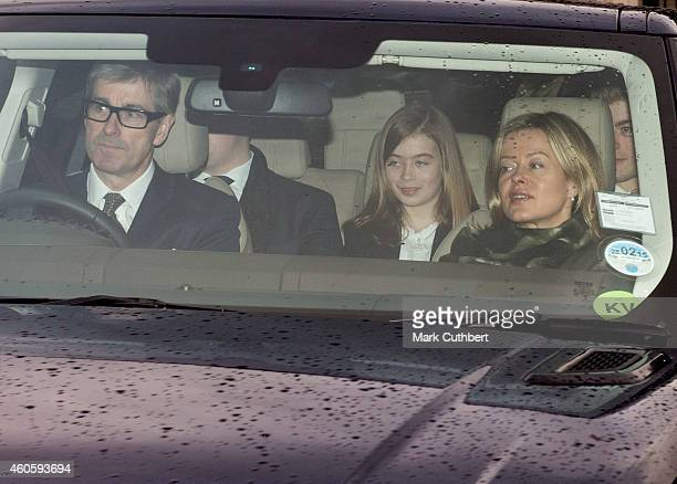 Lady Helen Taylor and Tim Taylor with Eloise Taylor attend a Christmas Lunch at Buckingham Palace on December 17 2014 in London England
