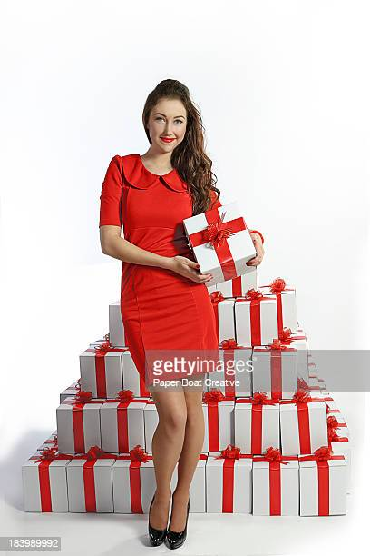 lady holding a box with red ribbon