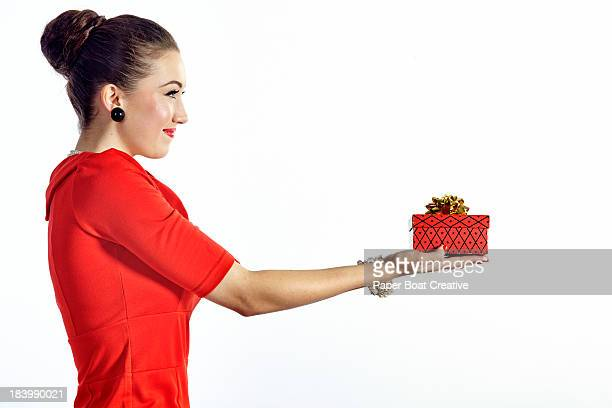 lady holding a small red gift box