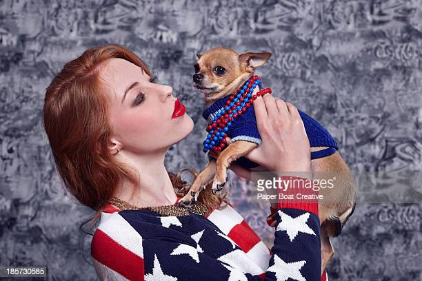 Lady holding her pet chihuahua