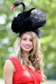 A lady in a hat poses for a photograph on Ladies Day at Royal Ascot at Ascot Racecourse on June 14 2011 in Ascot United Kingdom