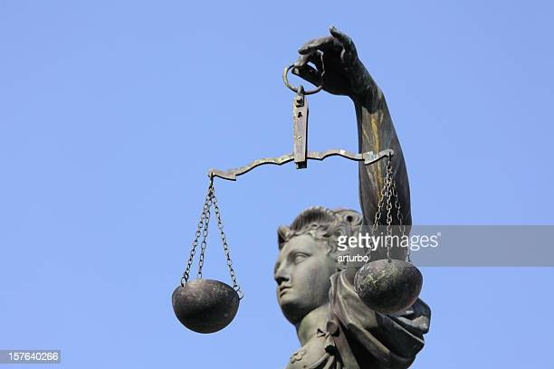 Lady Justice statue with scale side view