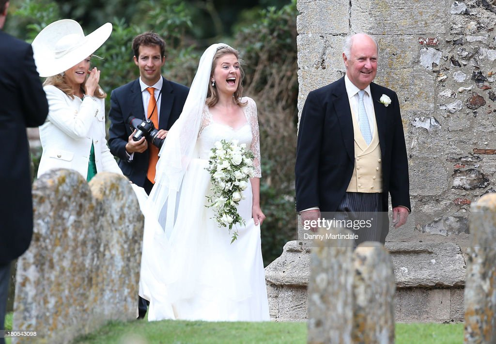 Lady Laura Marsham arrives for her wedding to James Meade at the parish church of St Nicholas at Gayton on September 14, 2013 in King's Lynn, England.