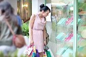 lady looking at colorful desserts by the window