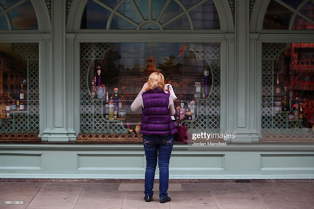 A lady looks into the one of the window displays at the front of Fortnum and Mason on May 5, 2013 in London, England. Fortnum and Mason have kept bees on their rooftop terrace for the last 7 years. At this time of year, the London Honey Company return the bees to their renovated hives.