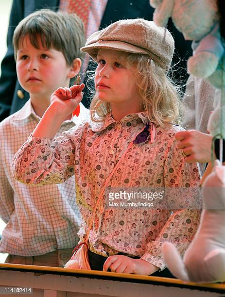 Lady Louise Windsor plays darts at the fairground as she attends day 4 of the Royal Windsor Horse Show on May 14 2011 in Windsor England