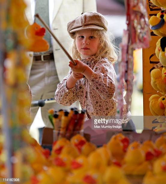 Lady Louise Windsor plays 'Hook a Duck' at the fairground as she attends day 4 of the Royal Windsor Horse Show on May 14 2011 in Windsor England