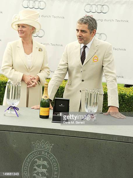 Lady March and Rowan Atkinson present The Magnolia Cuup during Ladies Day at Glorious Goodwood held at Goodwood Racecourse on August 2 2012 in...