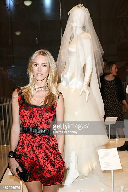 Lady Mary Charteris poses next to her wedding dress designed by Pam Hogg as she attends the Wedding Dresses 17752014 Exhibition private view at the...