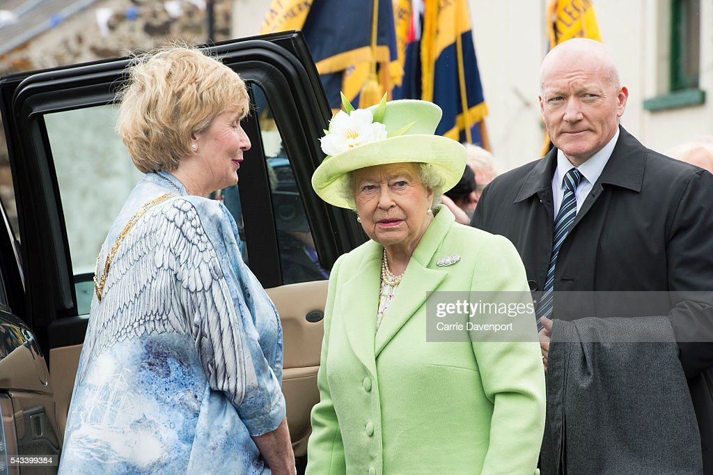 Lady Mauyor Maura Hickey greets Queen Elizabeth II & Prince Philip, Duke Of Edinburgh at the unveiling of the Robert Quigg VC memorial statue in Bushmills village on June 28, 2016 in Bushmills, Northern Ireland.
