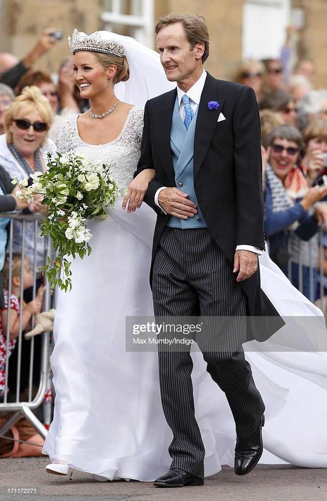 Lady Melissa Percy escorted by her father Ralph Percy, Duke of Northumberland arrive at St Michael's Church for her wedding on June 22, 2013 in Alnwick, England.