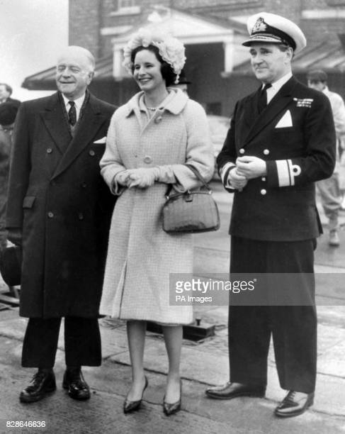 Lady Miers wife of Rear Admiral Sir ACC Miers pictured with the High Commissioners for Canada the Hon Lionel Chevrier and Rear Admiral ILT Hogg