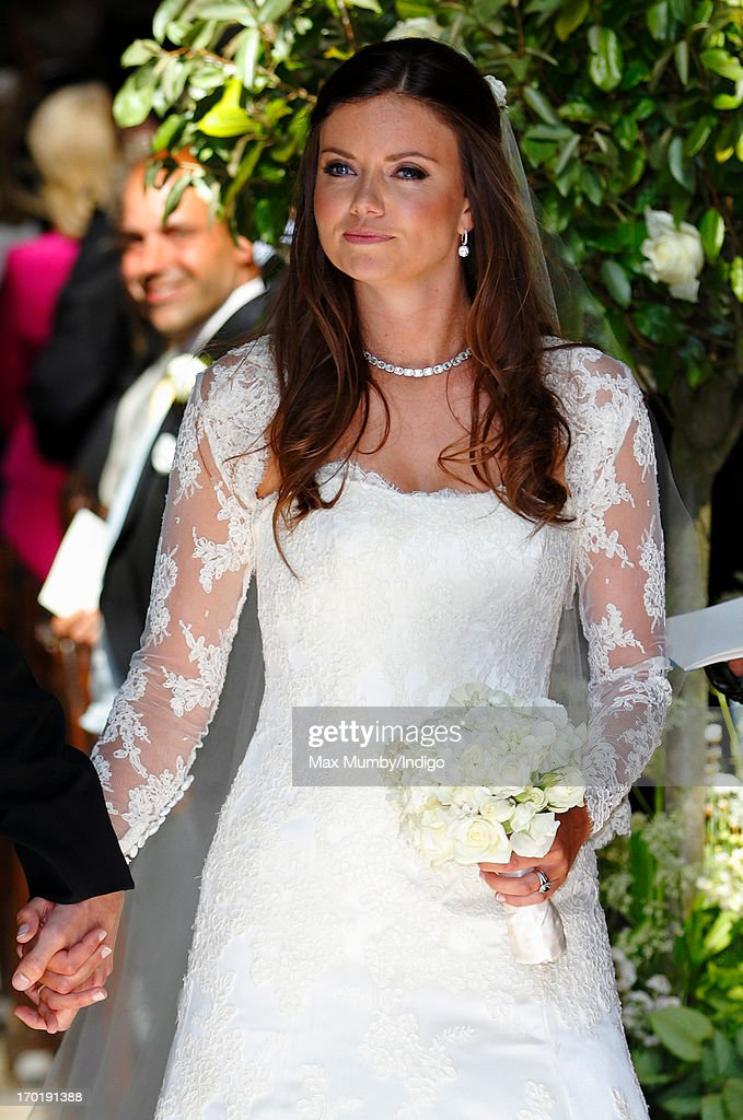 Lady Natasha Rufus Isaacs leaves the church of St John the Baptist after her and Rupert Finch's wedding on June 8, 2013 in Cirencester, England.