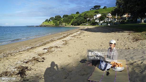 Lady nearing retirement age enjoying beach.