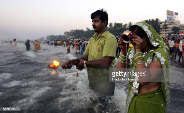A lady offering prayers to the sun god on the occasion of Chhat Puja at Juhu beach on Tuesday in Mumbai