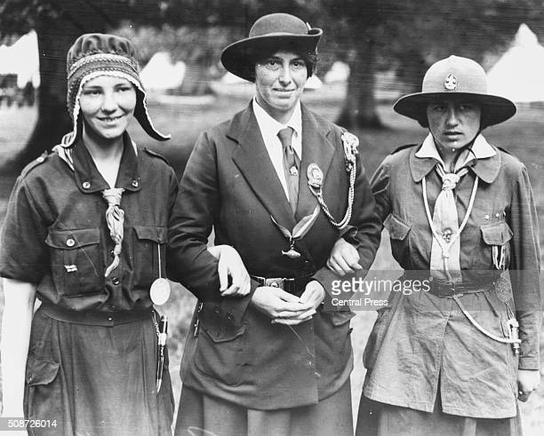 Lady Olave BadenPowell the Chief Guide of the World and widow of the founder of the Boy Scout Movement pictured with two of her girl guides at a camp...