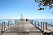 Lady on the pier at Hervey Bay, Queensland Australia.