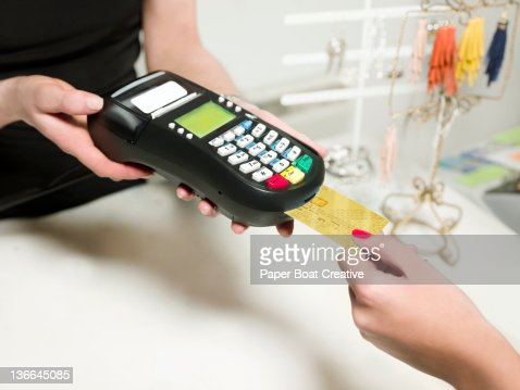 Lady paying at the till with her credit card : Stock Photo