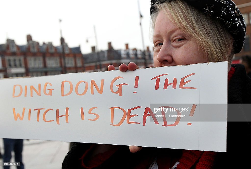 A lady poses behind a sign displaying the message 'Ding Dong! The Witch is Dead!' as she celebrates the death of former British Prime Minister Margaret Thatcher in Brixton on April 8, 2013 in London, England. Lady Thatcher has died this morning following a stroke aged 87. Margaret Thatcher was the first female British Prime Minster and governed the UK from 1979 to 1990. She led the UK through some turbulent years and contentious issues including the Falklands War, the miners' strike and the Poll Tax riots.