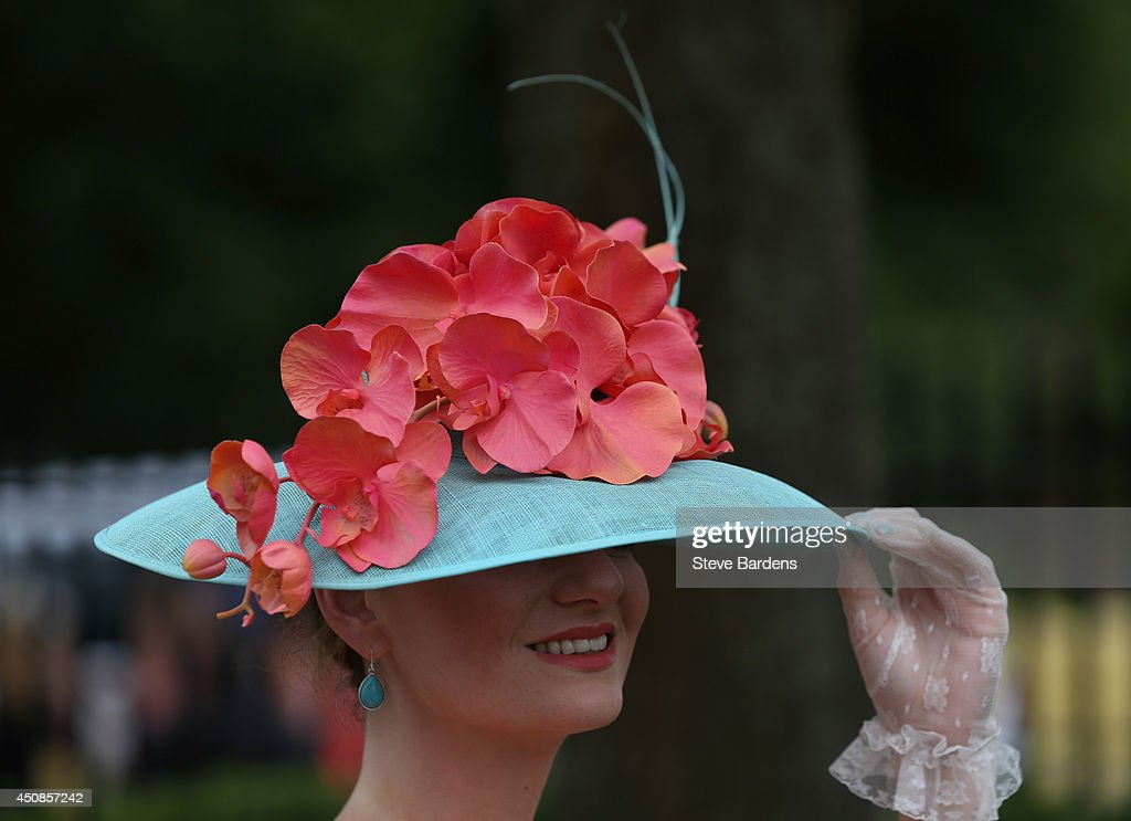 Lady racegoer wearing a floral hat on day three of Royal Ascot at Ascot Racecourse on June 19 2014 in Ascot England