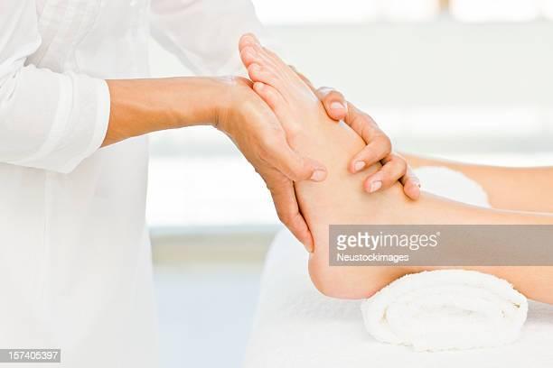 Lady recieving foot massage at spa