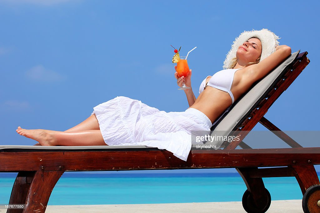 Lady relaxing in the chaise lounge on a exotic resort.  Stock Photo : the chaise lounge - Sectionals, Sofas & Couches