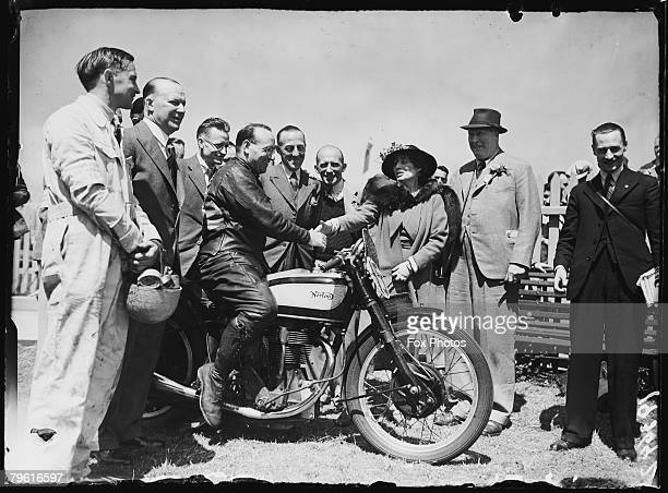 Lady Rose LevesonGower Countess Granville elder sister of Queen Elizabeth congratulates Harold Daniell on winning the Senior TT Race on the Isle of...