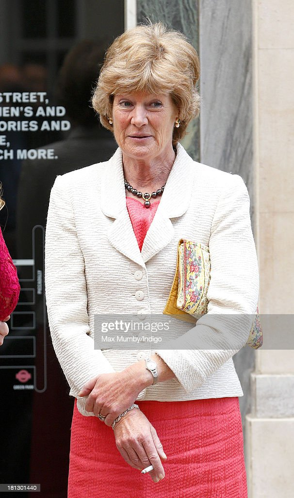 Lady <a gi-track='captionPersonalityLinkClicked' href=/galleries/search?phrase=Sarah+McCorquodale&family=editorial&specificpeople=2136543 ng-click='$event.stopPropagation()'>Sarah McCorquodale</a> smokes a cigarette outside Claridges Hotel before attending the wedding reception for Alexander Fellowes (her nephew) and Alexandra Finlay following their wedding ceremony at the Chapel of St Mary Undercroft in the Palace of Westminster on September 20, 2013 in London, England.