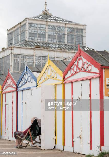 A lady sits next to her beach hut on August 12 2017 in Great Yarmouth England A cloudy overcast day greeted visitors to the Norfolk seaside town on...