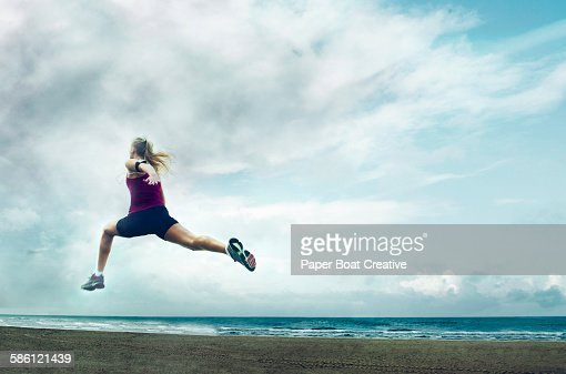 lady springing fast by the beach side during storm