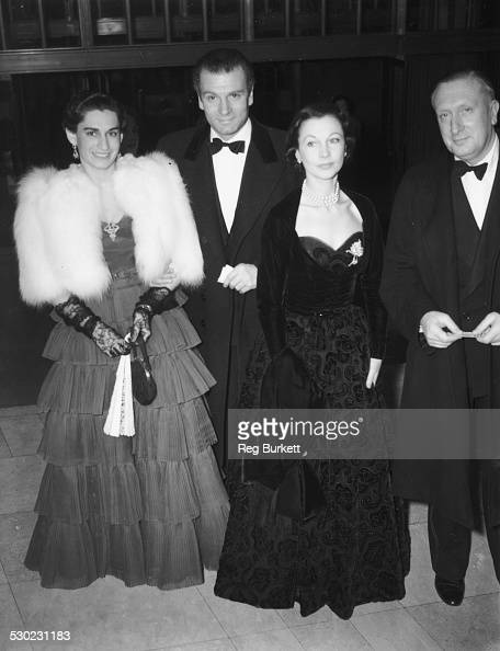 Lady Susana Walton Sir Lawrence Olivier and Vivien Leigh arriving together at Royal Festival Hall for a performance conducted by Arturo Toscanini...