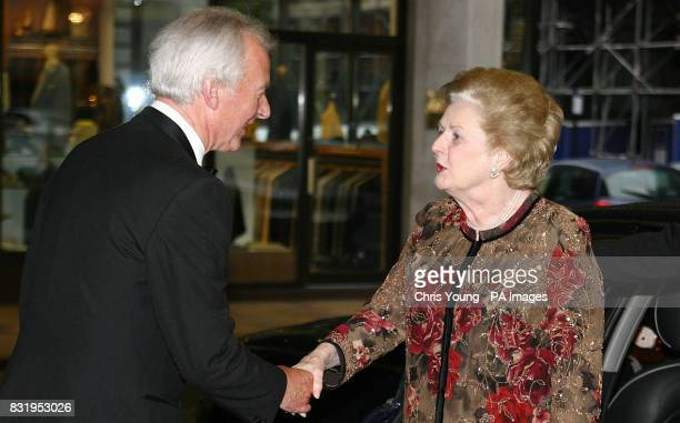 Lady Thatcher is greeted by Sir Michael Spicer as they arrive at a dinner organised by the 1922 Committee of Conservative peers and MPs in tribute to...