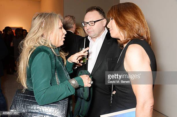 Lady Tina Green Jonathan Shalit and Kay Burley attend a private view of 'And The Stars Shine Down' by Stasha Palos at the Saatchi Gallery on December...