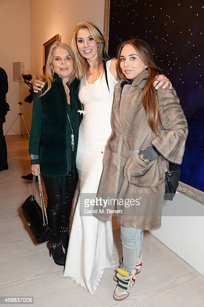 Lady Tina Green Stasha Palos and Chloe Green attend a private view of 'And The Stars Shine Down' by Stasha Palos at the Saatchi Gallery on December 2...