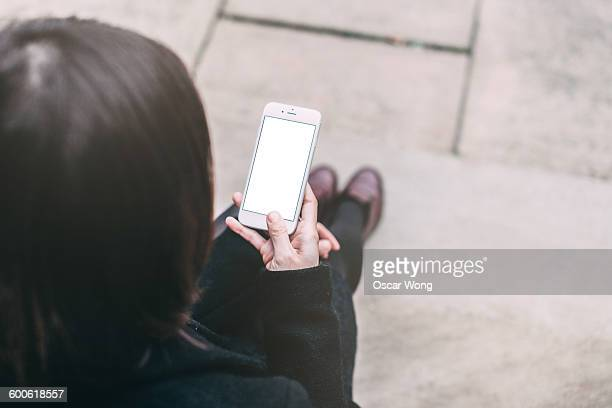 Lady using smartphone outdoor