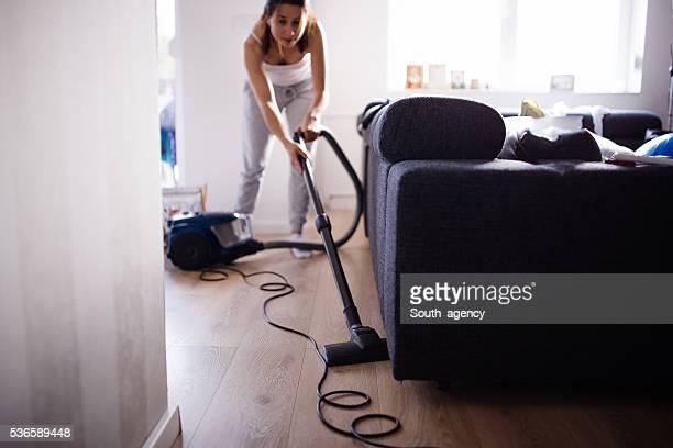 Lady vacuuming living room