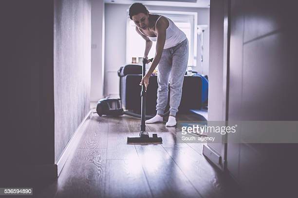 Lady vacuuming the laminate