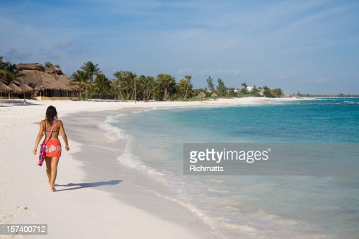 Lady Walking Alone on the Beach