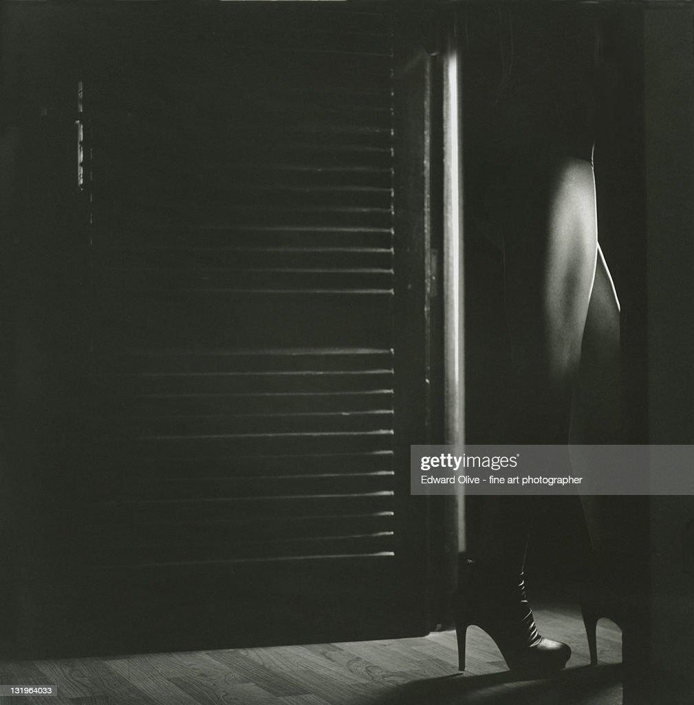 Lady walking through door : Stock Photo