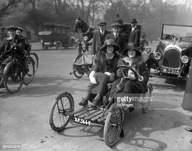 Lady Warrender out for a drive with Audrey James in an early rearmounted engine car