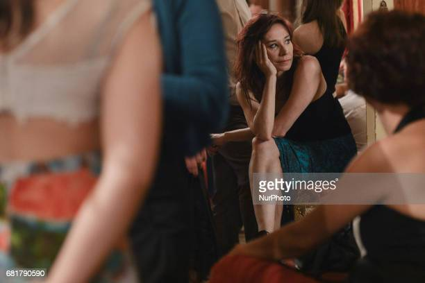 A lady watches Argentine tango dancers performing during an evening milonga event in Juliusz Slowacki Theatre an event that was a part of Krakus...