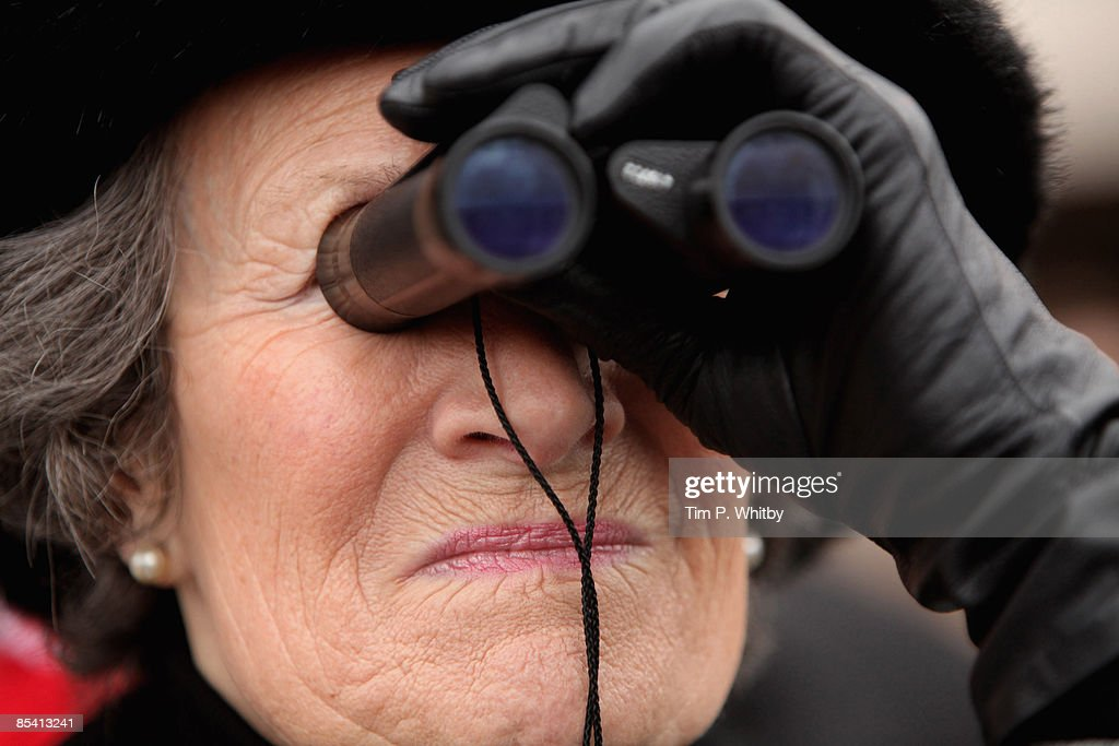 A lady watches the action on Day Four of the Cheltenham Festival at the Cheltenham racecourse on March 13, 2009 in Cheltenham, England.