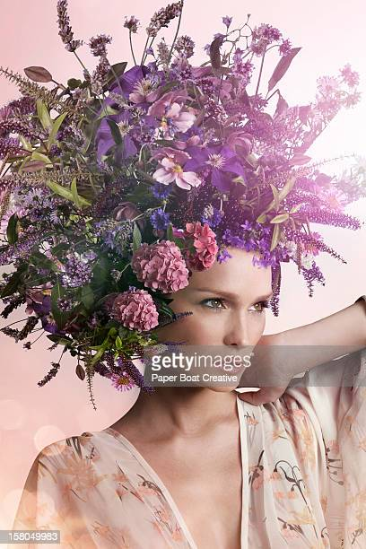 Lady wearing a big purple hat made of flowers