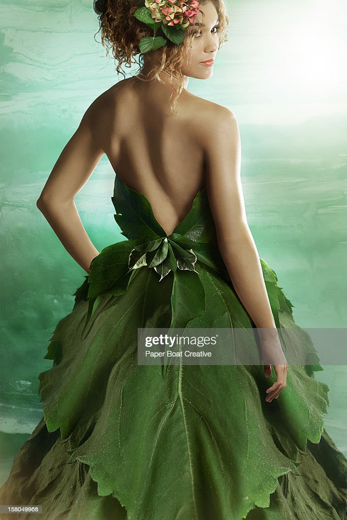 Lady wearing a fashionable dress made of leaves : Stock Photo