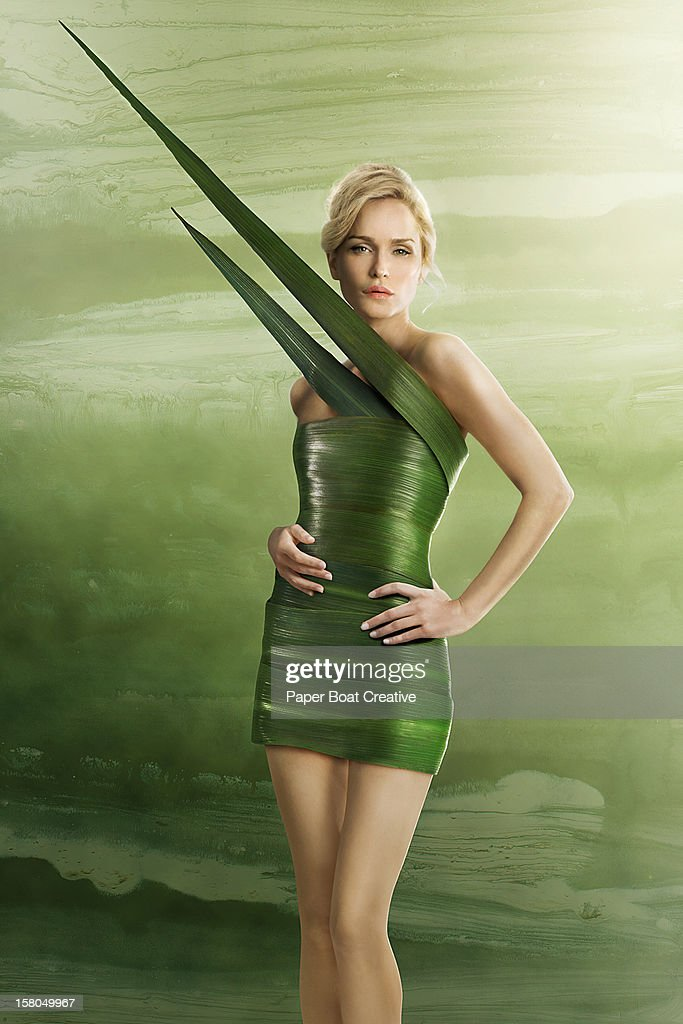 Lady wearing a fitted fashion dress made of leaves