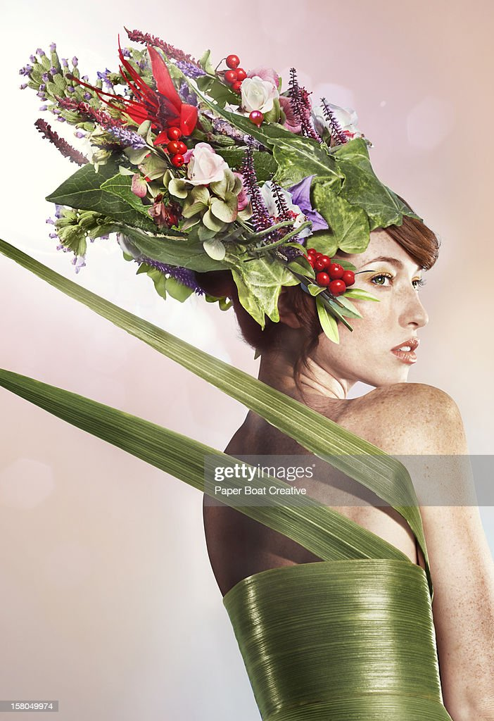 lady wearing a green dress and floral hat : Stock Photo