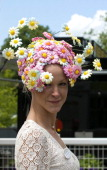 A lady wearing A hat poses during Ladies Day at Royal Ascot Thursday 19th June 2008