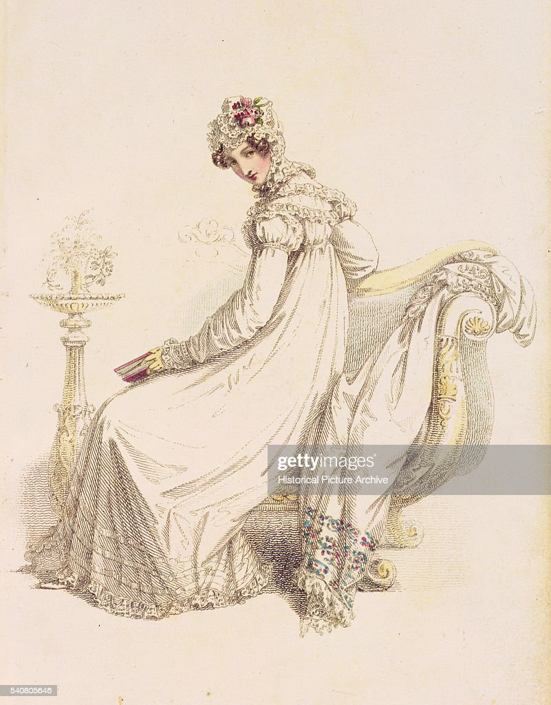 A lady wears an Empire line highnecked shift dress with long sleeves accompanied with a lace cap