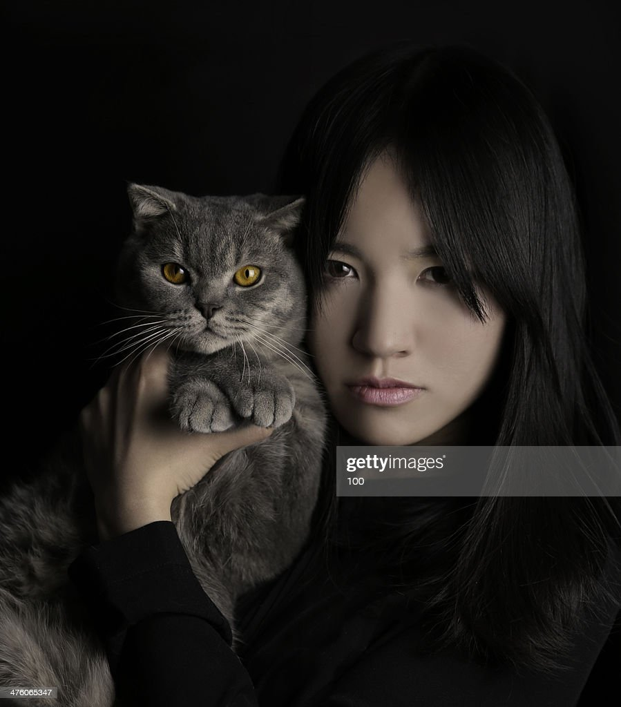 Lady with cat : Stock Photo